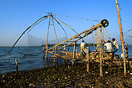 Men at work with fishing nets in Fort Cochin.
