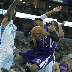 20 December 2008: Sacramento Kings guard Bobby Brown (5) drives to the basket between Hornets defenders Rasual Butler (45) and Chris Paul (3)  during a NBA regular season game between the Sacramento Kings and the New Orleans Hornets at the New Orleans Arena in New Orleans, LA. .