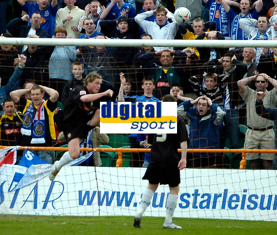 Photo: Ed Godden.<br />Barnet v Stockport County. Coca Cola League 2. 29/04/2006. Simon King (L) clears the ball out of the Barnet goal. Much to the dismay of the Stockport fans (behind the goal).