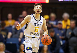 Dec 30, 2018; Morgantown, WV, USA; West Virginia Mountaineers guard Jordan McCabe (5) dribbles the ball during the second half against the Lehigh Mountain Hawks at WVU Coliseum. Mandatory Credit: Ben Queen-USA TODAY Sports