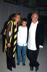 MR & MRS ROLF SACHS and their son FREDERICK SACHS at an exhibition of work by Rolf Sachs - a unique world-renowned contemporary furniture designer, held in association with the Louisa Guinness Gallery and held at 250 Brompron Road, London on 6th October 2004.<br />