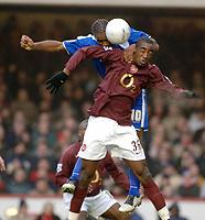 Photo: Daniel Hambury.<br />Arsenal v Cardiff City. The FA Cup. 07/01/2006.<br />Arsenal's Johan Gilbert (R) and Cardiff's Cameron Jerome battle for the ball.