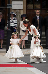 29 April 2011. London, England..Royal wedding day. Maid of Honour Pippa Middleton arrives at Westminster Abbey with bridesmaids Grace Van Cutsem (l) and Eliza Lopez..Photo; Charlie Varley.
