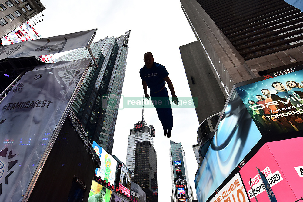 A member of the USA Freestyle Skiing Team demonstrates maneuvers on a trampoline during the Team USA Winter Fest  - 100 day countdown to the 2018 Winter Olympics, in Times Square, New York, on November 1, 2017. (Photo by Anthony Behar/Sipa USA)