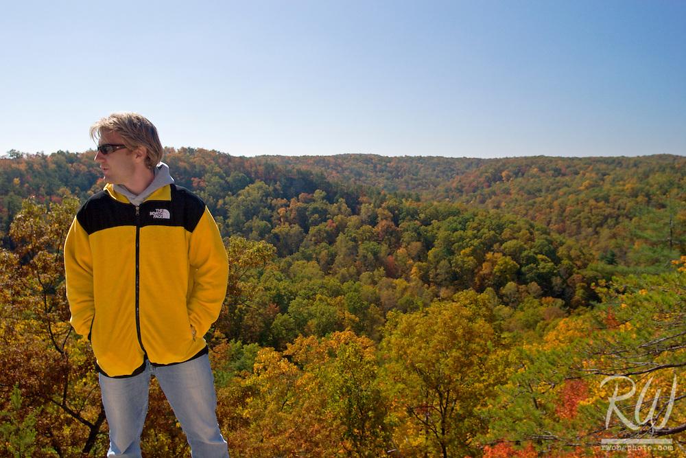 Jeff Pospichal Standing Atop Natural Bridge While Wearing a North Face Jacket at Natural Bridge State Resort Park, Kentucky