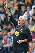 Steve Bruce signals to the field during the Sky Bet Championship match between Hull City and Queens Park Rangers at the KC Stadium, Kingston upon Hull, England on 19 September 2015. Photo by Ian Lyall.