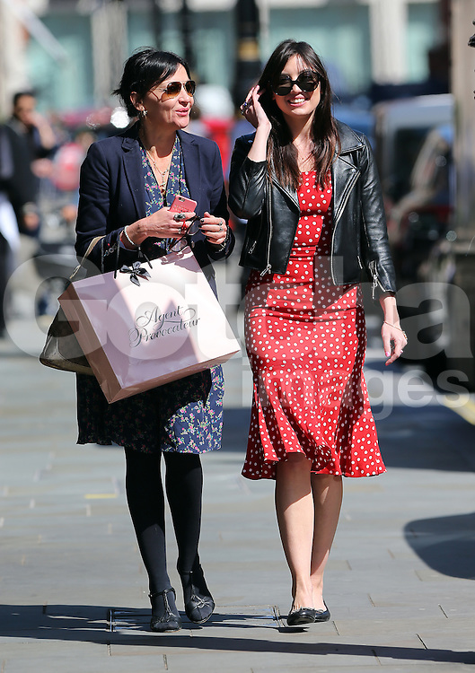 (EXCLUSIVE PICTURES) Model Daisy Lowe wearing a black leather bikers jacket, red &amp; white polka-dot dress and a pair of Chanel pumps, treats her mum Pearl Lowe for lunch at Scott's restaurant in Mayfair, London, UK. 20/04/2016 <br />