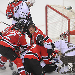 June 9, 2012: New Jersey Devils goalie Martin Brodeur (30) is pulled out of a scrum by Los Angeles Kings center Jeff Carter (77) during third period action in game 5 of the NHL Stanley Cup Final between the New Jersey Devils and the Los Angeles Kings at the Prudential Center in Newark, N.J. The Devils defeated the Kings 2-1.