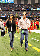 Actor Matthew McConaughey and his longtime girlfriend Camilia Alves strut down the New Orleans Saints sideline prior to the kickofff Sunday Nov. 21,2010 in New Orleans Louisiana in the Super Dome. The Saints went on to beat the Seahawks 34-19. Photo©SuziAltman.
