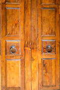 Wooden door and knockers, Florence, Tuscany, Italy