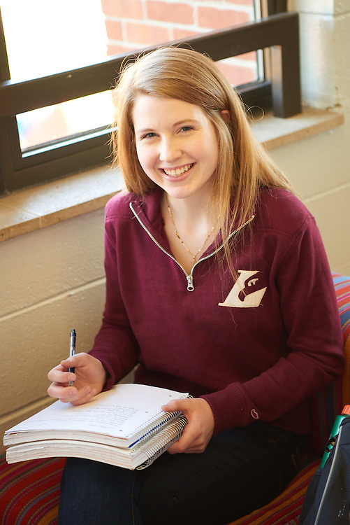 -UWL UW-L UW-La Crosse University of Wisconsin-La Crosse; Couch; day; December; Eagle L; Graff Main Hall; Inside; Notepad; Pen; Pencil; Portrait; Smiling; Student students; Studying; Woman women