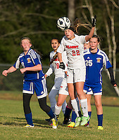 Kelsey Scott heads the ball during NHIAA first round Division III tournament soccer at Belmont High School Wednesday afternoon.  (Karen Bobotas/for the Laconia Daily Sun)