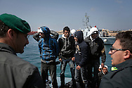 ITALY, Lampedusa :Tunisian migrants arrive in  Lampedusa on March 26, 2011. Copyright Christian Minelli.
