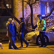 Police attend a siege situation in Old Shettleston Road, Glasgow. Local people try to find out what is going on.  Picture Robert Perry 14th April 2016<br /> <br /> Must credit photo to Robert Perry<br /> FEE PAYABLE FOR REPRO USE<br /> FEE PAYABLE FOR ALL INTERNET USE<br /> www.robertperry.co.uk<br /> NB -This image is not to be distributed without the prior consent of the copyright holder.<br /> in using this image you agree to abide by terms and conditions as stated in this caption.<br /> All monies payable to Robert Perry<br /> <br /> (PLEASE DO NOT REMOVE THIS CAPTION)<br /> This image is intended for Editorial use (e.g. news). Any commercial or promotional use requires additional clearance. <br /> Copyright 2014 All rights protected.<br /> first use only<br /> contact details<br /> Robert Perry     <br /> 07702 631 477<br /> robertperryphotos@gmail.com<br /> no internet usage without prior consent.         <br /> Robert Perry reserves the right to pursue unauthorised use of this image . If you violate my intellectual property you may be liable for  damages, loss of income, and profits you derive from the use of this image.