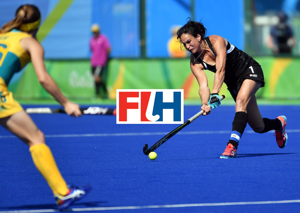 New Zealand's Kayla Whitelock hits the ball during the the women's quarterfinal field hockey New Zealand vs Australia match of the Rio 2016 Olympics Games at the Olympic Hockey Centre in Rio de Janeiro on August 15, 2016. / AFP / Pascal GUYOT        (Photo credit should read PASCAL GUYOT/AFP/Getty Images)