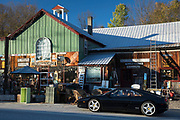 Driver of Ferrari sports coupe car stops at Hillbilly Recycling store in Bridgewater, Vermont, New England, USA