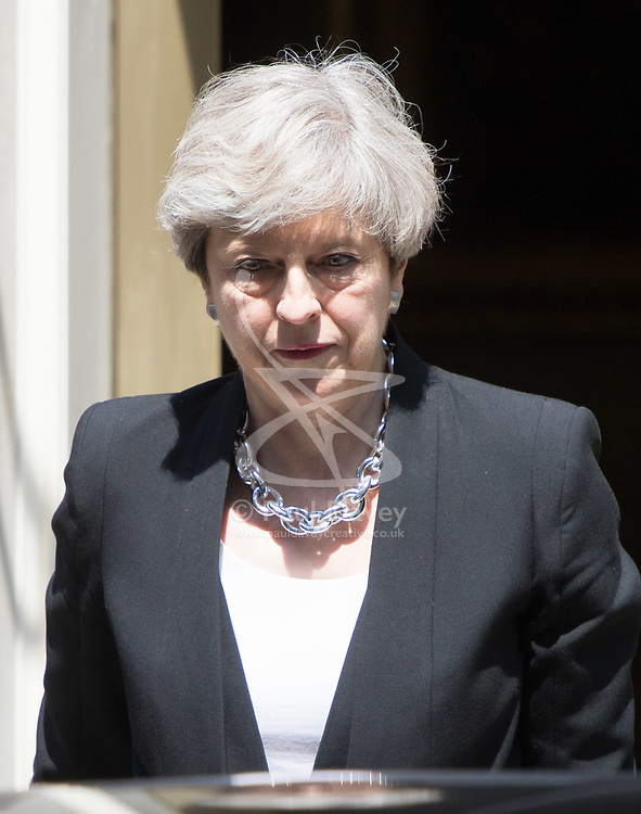 London, June 19th 2017. British Prime Minister Theresa May leaves Downing Street to visit the scene of the Finsbury Park Terrorist incident in which one Muslim man was killed and ten were hurt after being run over by a van.