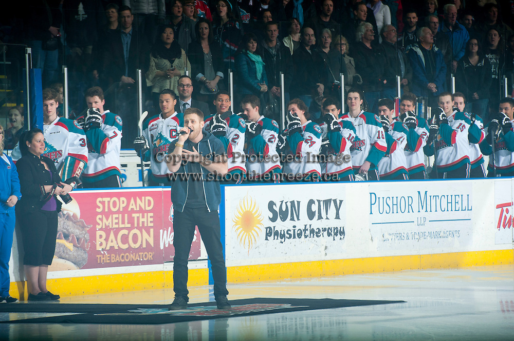 KELOWNA, CANADA - MARCH 7: Anthem singer Jeff Piatelli encourages the fans to sing along as the Kelowna Rockets host the Spokane Chiefs on March 7, 2015 at Prospera Place in Kelowna, British Columbia, Canada.  (Photo by Marissa Baecker/Shoot the Breeze)  *** Local Caption *** Jeff Piatelli;