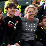 March 1, 2014, Palm Springs, California: <br /> WTA player Coco Vandeweghe poses for a photograph with kids during Kids Day at the Indian Wells Tennis Garden sponsored by the Coachella Valley National Junior Tennis and Learning Network.<br /> (Photo by Billie Weiss/BNP Paribas Open)