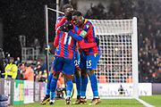 Crystal Palace #11 Wilfried Zaha, Crystal Palace #26 Bakary Sako, Crystal Palace #15 Jeffrey Schlupp, celebrates after scoring goal in last minute during the Premier League match between Crystal Palace and Watford at Selhurst Park, London, England on 12 December 2017. Photo by Sebastian Frej.