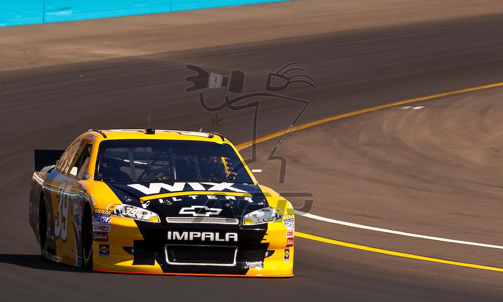 AVONDALE, AZ - MAR 03, 2012:  Ryan Newman (39) brings his NASCAR Sprint Cup car through turn 4 during qualifying for the Subway Fresh Fit 500 race at the Phoenix International Raceway in Avondale, AZ.
