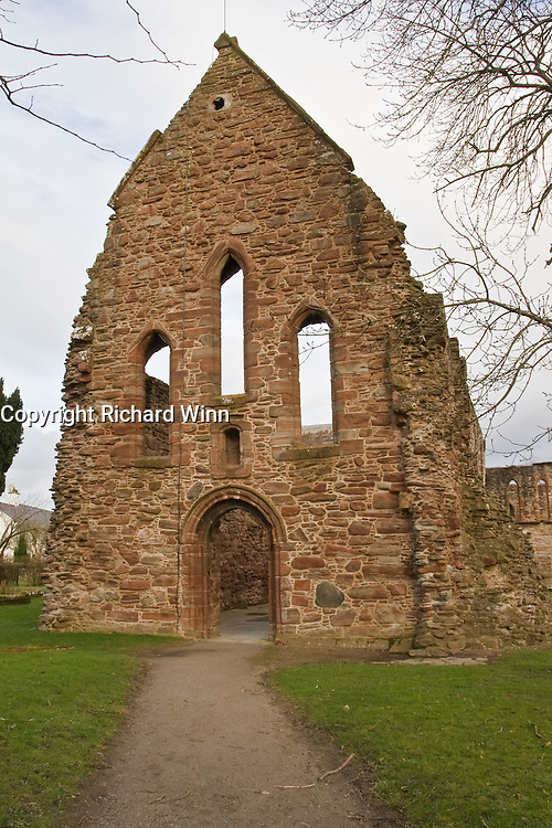 Front entrance of the ruins of Beauly Priory in Inverness-Shire, Scotland. Many priories in England, Scotland and Wales were left to decay after the dissolution by King Henry VIII. Some exposure compensation and tweaks to the contrast.
