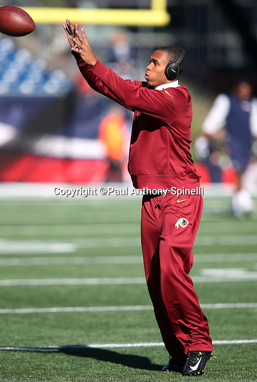 Washington Redskins cornerback Quinton Dunbar (47) catches a pregame pass while warming up before the 2015 week 9 regular season NFL football game against the New England Patriots on Sunday, Nov. 8, 2015 in Foxborough, Mass. The Patriots won the game 27-10. (©Paul Anthony Spinelli)