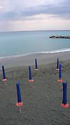 Umbrellas on the beach, Monterosso al Mare, Italy.