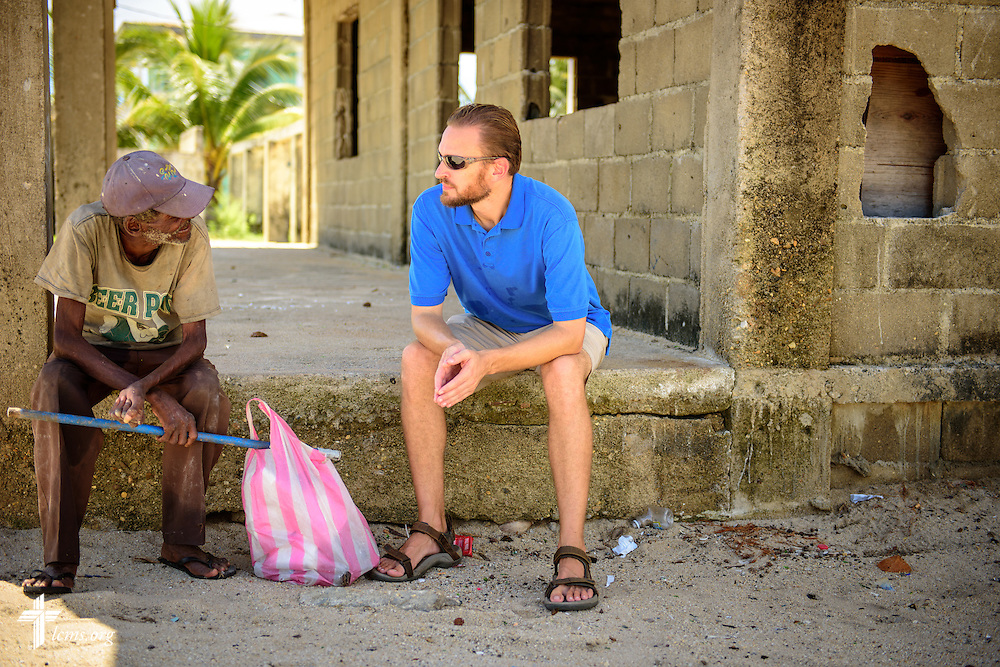 The Rev. Duane Meissner, career missionary to Belize, talks to a man on the beach on Tuesday, Sept. 27, 2016, in Seine Bight, Belize. Meissner's objective is to plant the first Lutheran churches in the country. LCMS Communications/Erik M. Lunsford