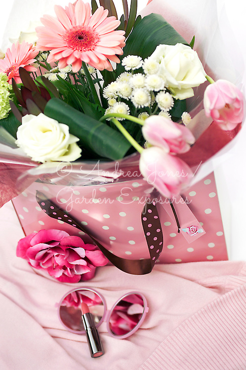 St Valentines Day gift bag bouquet of cut flowers including Gerbera, Tulip, Hydrangea & Roses. Small make up mirror & lipstick