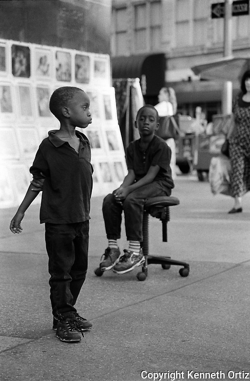 Two young boys wait around Columbus Circle on the West side of Manhattan.