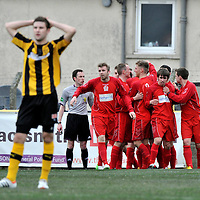 Auchinleck Talbot v Rutherglen Glencairn, Emirates Junior Cup semi final 1st leg, Beechwwod Park, Auchinleck. Glencairn celebrate their equaliser whilst Talbot's  Craig Pettigrew stands with his hands on his head.  Picture Christian Cooksey