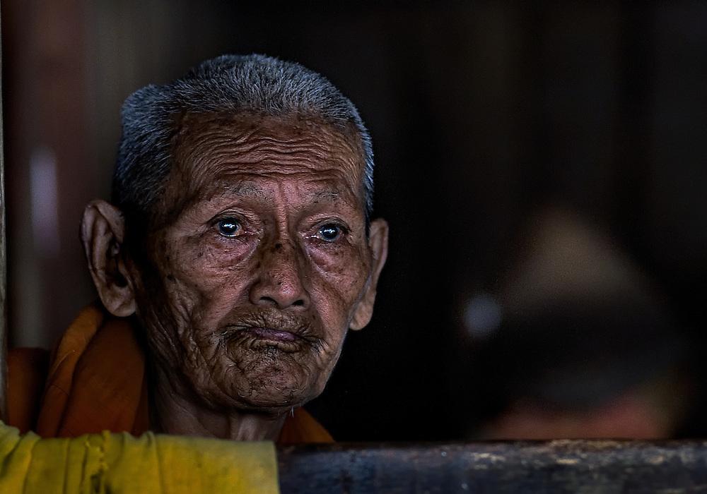 An old Buddhist monk in Luang Prabang, Laos.