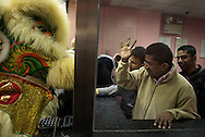 For a story by Dan Levin slug Hong Kong.February 20 2013, Kowloon, Hong Kong.At the Chungking Mansions, Indian money changers greeting the lion performing the traditional lion dance, a Chinese New Year ritual designed to bring prosperity. .Credit: Gilles Sabrie for The New York Times..
