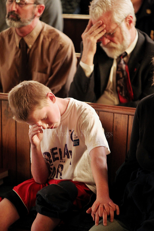 (060211  Monson, MA) Brandon Vreeland, 11, prays during a vigil at First Church in Monson, Thursday,  June 02, 2011.  Staff photo by Angela Rowlings.