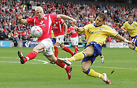Photo: Paul Thomas.<br /> Barnsley v Southampton. Coca Cola Championship. 19/08/2006.<br /> <br /> Bobby Hassell (L) of Barnsley tries to stop Rudi Skacel's shot at goal.