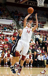 November 1, 2009; Stanford, CA, USA;  Stanford Cardinal forward Kayla Pedersen (14) shoots past Vanguard Lions guard Paige Halberg (23) during the second half at Maples Pavilion.  Stanford defeated Vanguard 107-49.