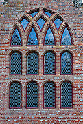 Stained glass windows and brick wall of a church. Historic Jamestowne is a National Historic Site that is part of Colonial National Historical Park, Virginia, USA. Jamestown was founded by the Virginia Company of London on May 14, 1607 on Jamestown Island, and is commonly regarded as the first permanent English settlement in what is now the United States of America. (Several earlier colonies failed.) Located in James City County when it was formed in 1634 as one of the original eight shires of Virginia, Jamestown was the capital of the Colony for 83 years, from 1616 until 1698. In 1698, the capital was relocated to Middle Plantation, about 8 miles (13 km) distant, a small community which was already home to the new College of William and Mary in 1693 and was renamed Williamsburg in 1699.