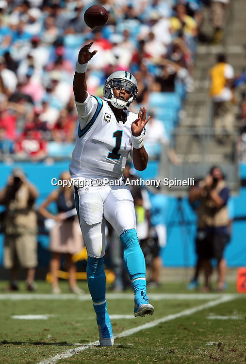 Carolina Panthers quarterback Cam Newton (1) throws a first quarter pass on his back foot during the 2015 NFL week 2 regular season football game against the Houston Texans on Sunday, Sept. 20, 2015 in Charlotte, N.C. The Panthers won the game 24-17. (©Paul Anthony Spinelli)
