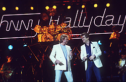 File photo : File photo of French singer and actor Johnny Hallyday (born Jean-Philippe Smet; 15 June 1943)pictured with Eddy Mitchell. France's biggest rock star Johnny Hallyday has died from lung cancer, his wife says. He was 74. The singer - real name Jean-Philippe Smet - sold about 100 million records and starred in a number of films. Photo by Jean-Claude Roca-MF/ABACAPRESS.COM