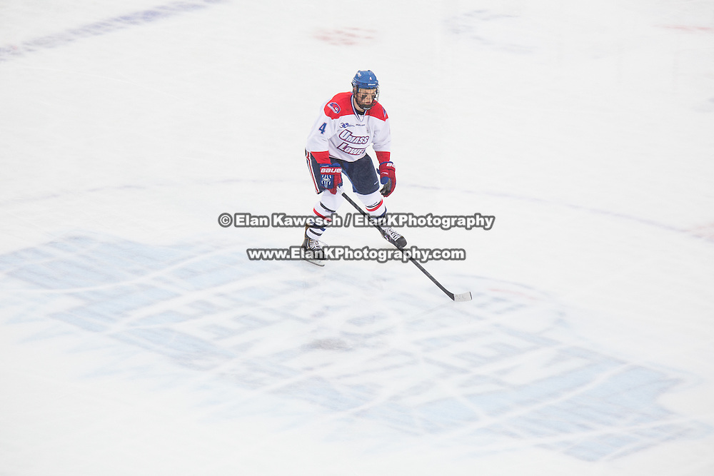Joe Houk #4 of the UMass Lowell Riverhawks in action during the Frozen Fenway game between The Northeastern Huskies and The UMass Lowell Riverhawks at Fenway Park on January 11, 2014 in Boston, Massachusetts.