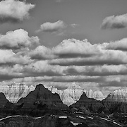 Clouds over buttes, Badlands National Park, South Dakota, USA.