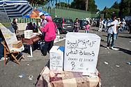Roma 30 Agosto 2011.Il mercato con i cibi  del mondo arabo fuori alla grande Moschea di Roma. La scatola per raccogliere lo  zakat al fitr (elemosina di fine Ramadan).