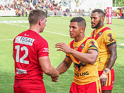 Handout photo dated 28/10/17 provided by NRL Photos of Wales' Ben Morris shakes hands with Papua New Guinea players after the Rugby League World Cup, Pool C match at the Oil Search National Football Stadium, Port Moresby.