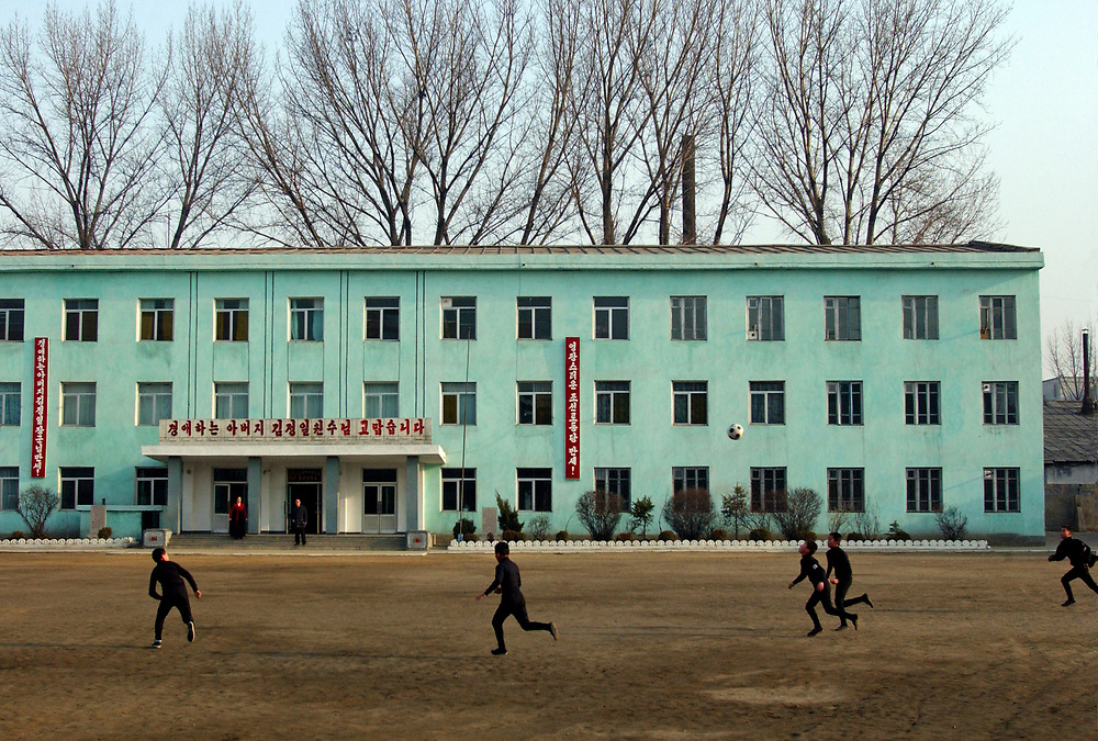 Boys playing football<br /> Kangan Primary school in Sonkyo District, Pyongyang<br /> <br /> copyright: Jeremy Horner 2004<br /> North Korea<br /> <br /> 2nd and 3rd grade classes visited<br /> <br /> (C)Jeremy Horner<br /> 15 Mar 2004