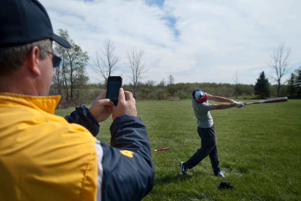 Lathan Goumas | MLive.com..April 17, 2012 - Goodrich High School baseball head coach Bob Foreback uses a cell phone to record a video of J.R. Dawley as he bats during a practice on Tuesday at Goodrich High School in Atlas Township. Foreback used his cell phone to video his players swings and then would analyze them to provide suggestions to improve hitting technique.