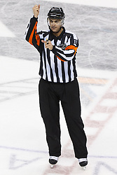 Mar 24, 2012; San Jose, CA, USA; NHL referee Frederick L'Ecuyer (17) during the third period between the San Jose Sharks and the Phoenix Coyotes at HP Pavilion.  San Jose defeated Phoenix 4-3 in shootouts. Mandatory Credit: Jason O. Watson-US PRESSWIRE