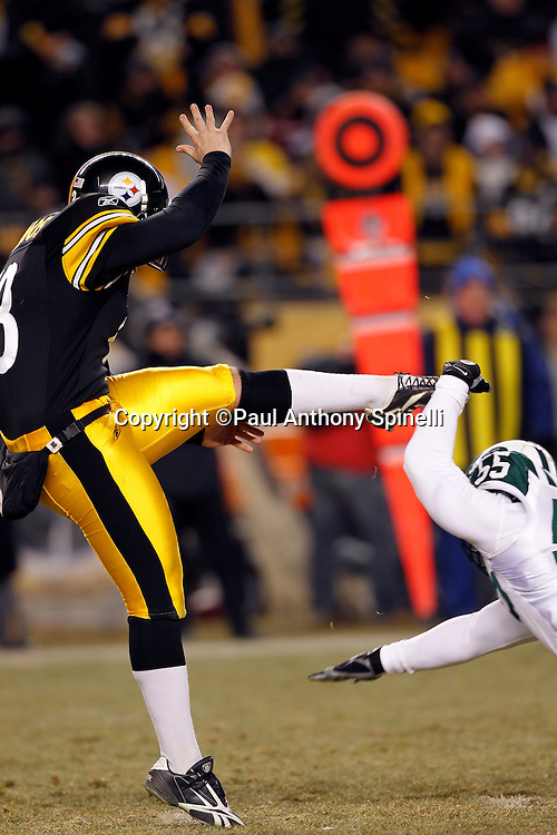 Pittsburgh Steelers punter Jeremy Kapinos (13) punts as he gets hit in the foot on a roughing the kicker penalty by New York Jets linebacker Jamaal Westerman (55) during the NFL 2011 AFC Championship playoff football game against the New York Jets on Sunday, January 23, 2011 in Pittsburgh, Pennsylvania. The Steelers won the game 24-19. (©Paul Anthony Spinelli)
