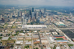 Aerial view of the skyline of Houston, Texas from EaDo with BBVA Stadium, George R Brown Convention Center, Minute Maid Stadium, Toyota Center in the foreground.
