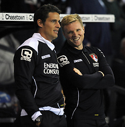 Bournemouth Manager, Eddie Howe laughs as he shares a joke with assistant manager, Jason Tindall - Photo mandatory by-line: Dougie Allward/JMP - Mobile: 07966 386802 - 30/09/2014 - SPORT - Football - Derby - Pride Park - Derby County v AFC Bournemouth - Sky Bet Championship